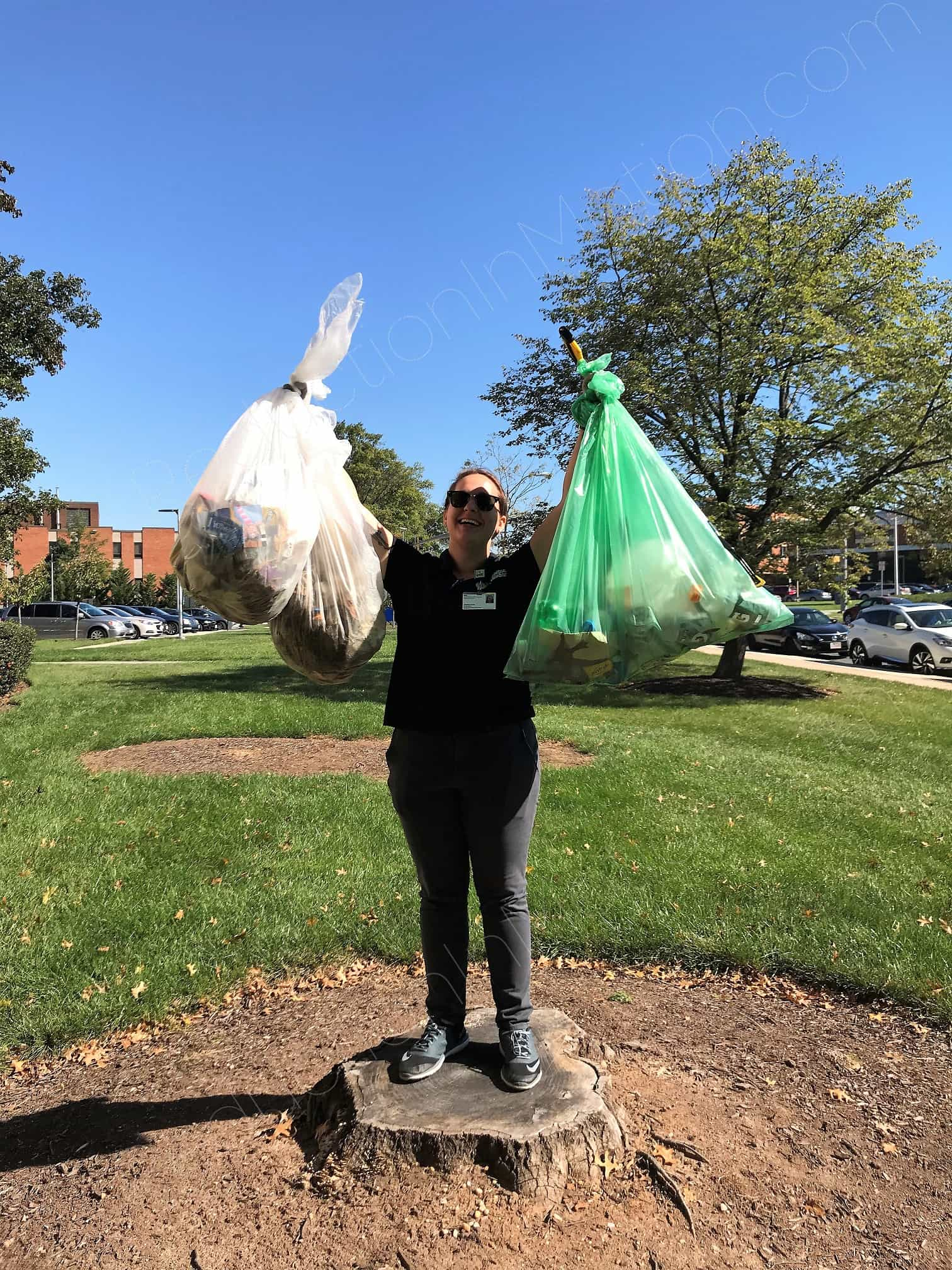 Person holding up bags of litter